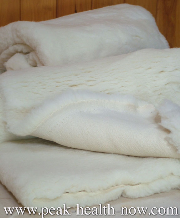 when you buy a wool mattress topper pillow or comforter from this site you are buying the very same products that surround me in warm luxuriant softness
